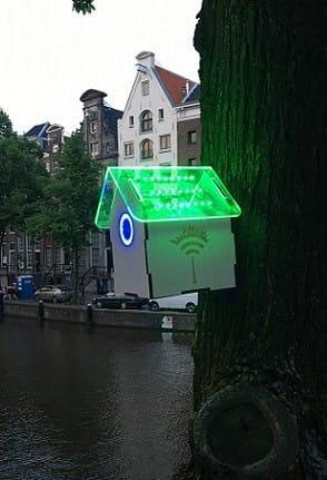 TreeWifi bird house illuminated by an Amsterdam canal